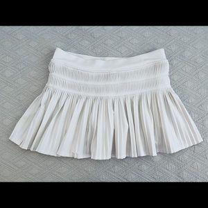 White pleated skort